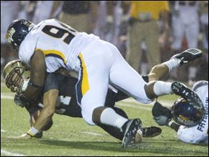 Toledo's Johnie Roberts tackles Western Michigan quarterback Johnie Roberts in last night's game.