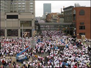 Participants packed Summit Street in Toledo for the 2009 race. Organizers hope to surpass last year's turnout of 18,129 and $925,000 in donations.