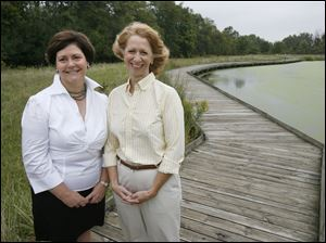 Country Garden Club president Mary Harman, left, and member Virginia Fairhurst Keller are on the boardwalk that the club helped finance at W.W. Knight Nature Preserve in Perrysburg.