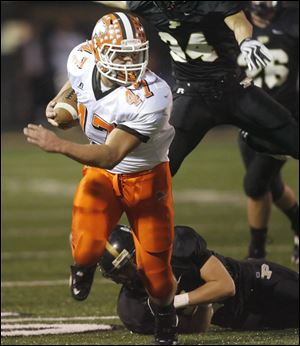 Southview's Jay Fisher turns the corner to gain yardage against Perrysburg in Friday night's NLL showdown.