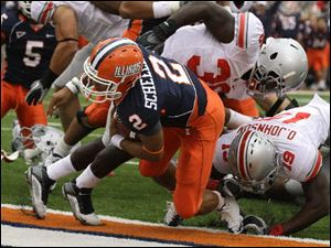 Illinois quarterback Nathan Scheelhaase scores past OSU's Orhian Johnson in Saturday's game.
