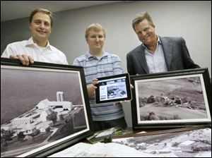 Paul Clark, left, Kevin Marsh, center, and Ken Krieg, founders of Vintage Aerials in Maumee, display aerial photographs in print and digital form.