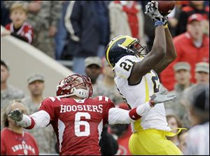 Michigan wide receiver Junior Hemingway makes a reception late in the game against Indiana's Richard Council to set up the game-winning touchdown.