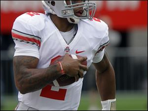 OSU's Terrelle Pryor made big plays by running but also suffered a minor thigh injury.