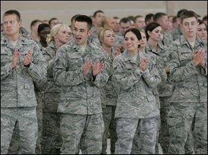 Members of the 180th Fighter Wing of the Ohio Air National Guard applaud their family members during a celebration to honor 22 'hometown heroes' at Toledo Express Airport.