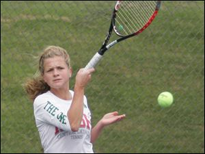 Central Catholic's Morgan delp hits a shot in her 6-1, 6-1 victory over Notre Dame's Megan McNamara in the City League tournament's No. 1 singles final at Jermain Park. The Irish won all three singles and both doubles finals to repeat as champions.