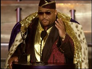 Solomon Burke, one of the pioneers of soul music, gestures to the audience after being inducted into the Rock and Roll Hall of Fame in this March 19, 2001.