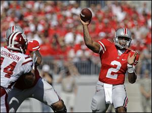 Ohio State's Terrelle Pryor flings one of his 30 passes on the day downfield. He completed 24 of them for 334 yards.