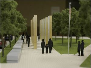 A scale-model view of Norman Lee's design that was considered to replace the Last Alarm memorial was presented three years ago.