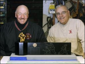 George Costic, left, and Bill Winkle would like to see a sculpture like the one pictured here in Chub DeWolfe Park.