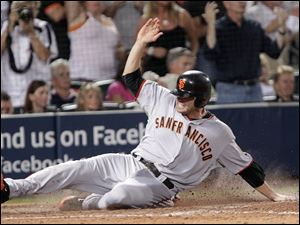 San Francisco's Freddy Sanchez slides in home with the go-ahead run against the Atlanta Braves on a ball hit by Buster Posey in the ninth inning. The Giants can win the series tonight.