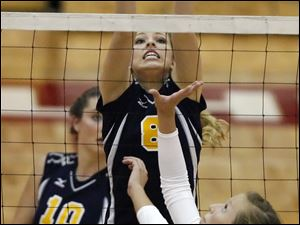 Notre Dame's Jocelyn Uchic (8) leaps for the ball against Central Catholic's Maggie Gilmore in the second semifinal at the Sullivan Center.