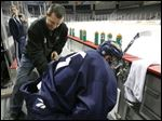 Walleye trainer Brad Fredrick works on the back of one of the players.