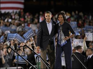 President Obama and First Lady Michelle Obama survey the crowd of 35,000 at a rally for Democrats at Ohio State University.