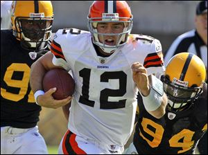 The Browns' Colt McCoy gains yardage after being flushed out of the pocket by the Steelers. 