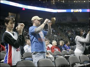 Joshua Jacobs, 13, was one of many fans dressed in Pistons attire as Detroit played in Toledo for the first time in 21 years.