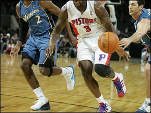 The Pistons' Rodney Stuckey slashes through the Wizards' defense. He was the star of the night with 34 points in Detroit's win.