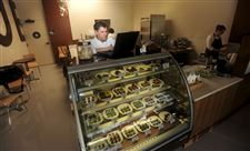Mark-West-a-chocolatier-checks-his-store-s-Foursquare-account-in-Palo-Alto-Calif