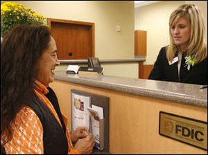 BIZ bank25p  Therese (cq) King, of Toledo, left, in the new branch with Sarah Florian, right. A new branch downtown for Fifth Third, replacing one they closed a block away a year ago, in Toledo, Ohio on October 25, 2010. Jetta Fraser/The Blade
