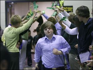 Twin lines of teachers offered celebratory high-fives to the students, including fourth grader Devyn-Vaughn Carmony.