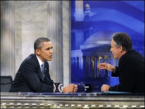Jon Stewart tries to get President Obama to show off his humorous side during Mr. Obama's first appearance on the 'Daily Show with Jon Stewart' since taking office.