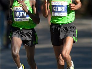 Ethiopia's Gebre Gebremariam, right, begins to pull away from Kenya's Emmanuel Mutai in Central Park. He won the race and took home $130,000.