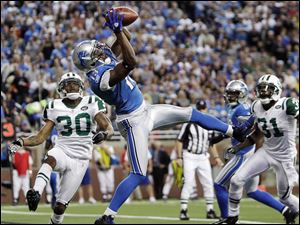 Detroit wide receiver Nate Burleson catches a two-yard touchdown pass against the New York Jets in the fourth quarter.