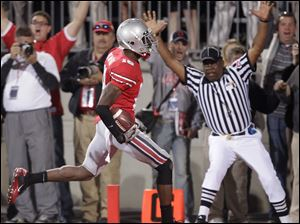 Ohio State defensive back Travis Howard picks off a Matt McGloin pass and returns it for a touchdown in the second half.