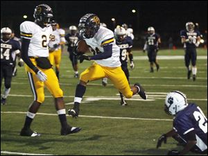 Whitmer's Jody Webb scores a touchdown against Twinsburg. Webb rushed for 139 yards.