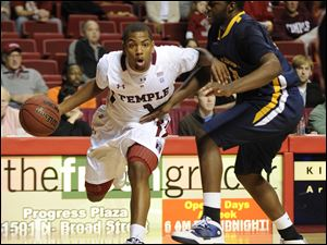 Temple's Khalif Wyatt drives past Toledo's Malcolm Griffin Sunday afternoon in Philadelphia.