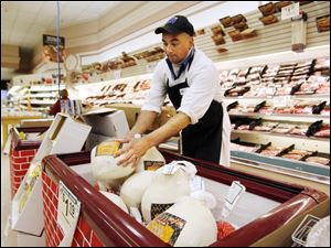 Meat manager Chuck Kiess adds more turkeys to the freezer on the floor at Walt Churchill's Market in Perrysburg.