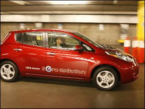 The Nissan Leaf, a 100% electric car, zero emissions vehicle, is test driven at the 2010 Los Angeles Auto Show.