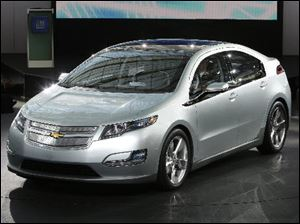 The Chevrolet Volt is unveiled at a General Motors centennial celebration in Detroit.