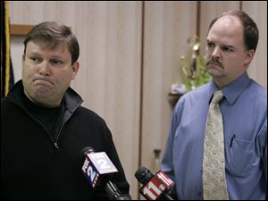 Andy Arena, FBI special agent for Michigan, left, and Morenci police chief Larry Weeks, talk about the investigation of the missing Skelton children in Morenci, Michigan Sunday.
