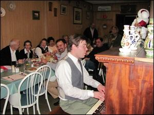 A co-owner of the Budapest, Rob McMahon, entertains the birthday celebrants.
