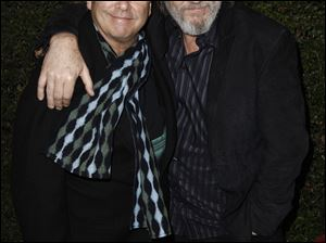 Jeff Bridges, right, poses with his brother Beau at the Los Angeles premiere of 'True Grit' on Thursday.