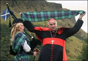 Cardinal Keith O'Brien unveils the first Papal visit plaid.