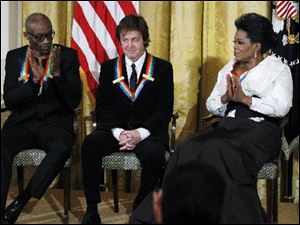 Bill T. Jones, and Oprah Winfrey applaud as fellow recipient Paul McCartney, center, is introduced by President Obama during a reception in the East Room of the White House in Washington.