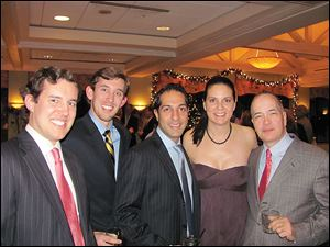 "From left, David Treece, Ben Treece, Amir Khan, Susan Pond, and Allan Block at Mr. Block's holiday party. <br> <img src=http://www.toledoblade.com/graphics/icons/photo.gif> <font color=red><b>PHOTO GALLERY:</b></font> ON THE TOWN: <a href=""/apps/pbcs.dll/gallery?Avis=TO&Dato=20101226&Kategori=COLUMNIST10&Lopenr=122609998&Ref=PH""_blank""> <b> Allan Block invites movers and shakers for cocktails</b></a>"