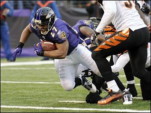 Ravens' running back Ray Rice dives across the goal line on a 7-yard run Sunday as Baltimore beat Cincinnati 13-7.