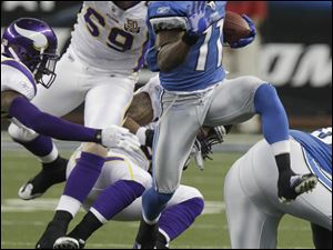 Lions wide receiver Stefan Logan breaks through the Minnesota defense after a catch Sunday in Detroit. Detroit goes into the offseason with its longest winning streak since 1999.