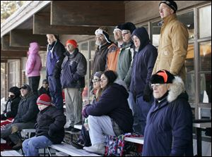 CTY roving10p 1/9/11  The Blade/Dave Zapotosky Well bundled spectators watch the hockey action during the Winter Chill Outdoor Festival at Ottawa Park Ice Rink, Sunday, January 9, 2011. 47 youth hockey teams played 28 games during the festival which ran fromThursday through Sunday. Teams from Pennsylvania, Indiana, Michigan, and Ohio, ranging in age from 8-17, participated in the event.
