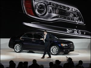 Chrysler's Olivier Francois quotes a little of Detroit's own Eminem as he speaks about the new Chrysler 300 at the North American International Auto Show in Detroit.