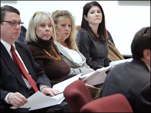 Rob Ludeman, left, Carol Dunn, Debbie Johnson, And Tara Kestner, members of the advisory committee listen as chairman Steve Serchuk explains the 15 recommendations. The group plans to meet next month and then once a year.