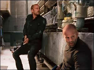 Ben Foster, left, plays the mechanic's protege Steve McKenna.