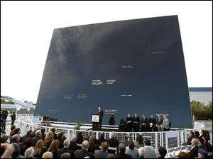 Stephen Feldman, at podium, president and CEO of the Astronauts Memorial Foundation speaks in front of the memorial during a rememberance ceremony to mark the 25th Anniversary of space shuttle Challenger explosion at the Kennedy Space Center visitor complex in Cape Canaveral, Fla., Friday.