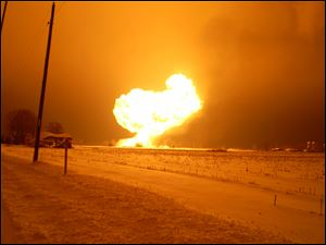 Burning ethanol lights the sky in Cass Township, just west of Arcadia, Ohio. Twenty-six train cars jumped the tracks, and the contents of those that ruptured caught fire.