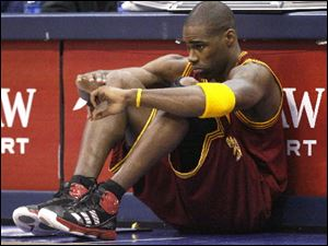 Cleveland Cavaliers power forward Antawn Jamison (4) sits in front of the scorer's tables waiting to be subbed in during the first half of the NBA basketball game against the Dallas Mavericks in Dallas.