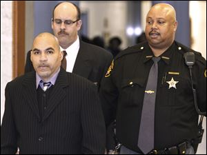 Ray A. Gott, left, is brought into court at the Lucas County Courthouse to begin his trial in the shooting death of Edward Christopher Lee and the injury of Sherlon McKenzie on April 4.