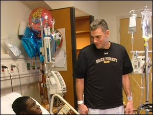 Wake Forest baseball coach Tom Walter, right, visits with player Kevin Jordan after donating a kidney to Jordan.